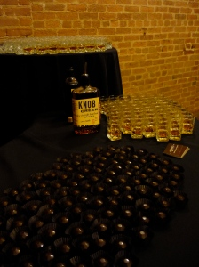 Hundreds of Bourbon chocolates and glasses of Bourbon artfully displayed on serving table
